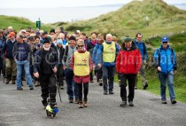 Tom Doherty, Elaine Hogan, Mick Queally and John Galvin lead the way during the Burren Ramble in aid of the RNLI at Fanore. Photograph by John Kelly