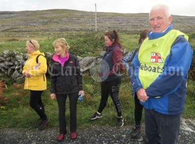 Joe Queally tells the story of the Fanore school scandal during the Burren Ramble on Sunday.