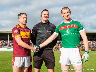 Gordon Kelly (C) of Miltown and Keith King (C) of Kilmurry Ibrickane, with referee Chris Maguire before their senior football county final at Cusack Park. Photograph by John Kelly.