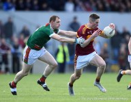 Eoin Cleary of Miltown in action against Keith King (C) of Kilmurry Ibrickane during their senior football county final at Cusack Park. Photograph by John Kelly.