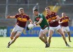 Shane Kickey of Kilmurry Ibrickane in action against Gordon Kelly and Eoin Cleary of Miltown during their senior football county final at Cusack Park. Photograph by John Kelly.
