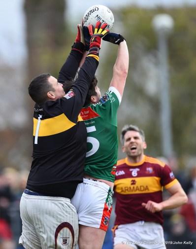 Sean O Brien of Miltown in action against Keelan Sexton of Kilmurry Ibrickane during their senior football county final at Cusack Park. Photograph by John Kelly.