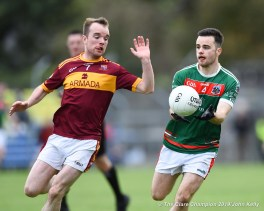 Ciaran Morrissey of Kilmurry Ibrickane in action against Gearoid Curtin of Miltown during their senior football county final at Cusack Park. Photograph by John Kelly.