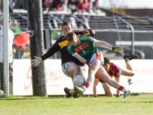 Sean O Brien of Miltown in action against Dermot Coughlan of Kilmurry Ibrickane during their senior football county final replay at Cusack Park. Photograph by John Kelly.