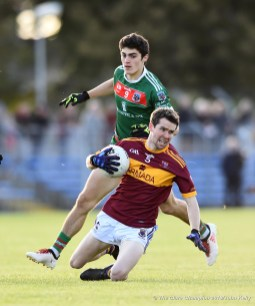 Aidan Mc Guane of Miltown in action against Aidan Mc Carthy of Kilmurry Ibrickane during their senior football county final replay at Cusack Park. Photograph by John Kelly.
