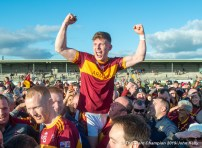 Cormac Murray of Miltown is held on high as players and supporters celebrate following their senior football county final replay win over KIB at Cusack Park. Photograph by John Kelly.