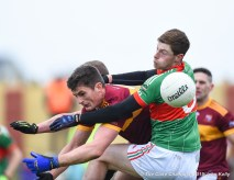 Conor Cleary of Miltown in action against Michael Curry (C) and Cathal Crowch of Rathgormack of during their Munster Club quarter final at Miltown. Photograph by John Kelly