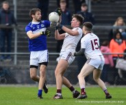 Tom Spillane of Templenoe in action against Padraig Kelly and Aidan Davidson of St Breckan's during their Munster Club Intermediate final at Mallow. Photograph by John Kelly