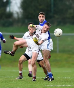 Dale Masterson of St Breckan's in action against Adrian Spillane of Templenoe during their Munster Club Intermediate final at Mallow. Photograph by John Kelly