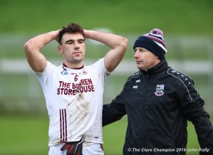 A disappointed Alan Sweeney, captain of St Breckan's, is consoled by mentor Declan O Keeffe following their Munster Club Intermediate final against Templenoe at Mallow. Photograph by John Kelly