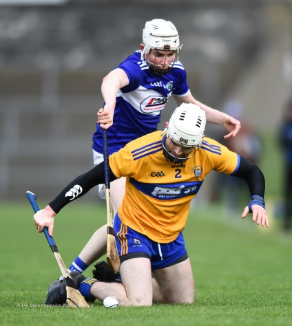 Liam Corry of Clare in action against Stephen Bergin of Laois during their National League game at Cusack Park. Photograph by John Kelly