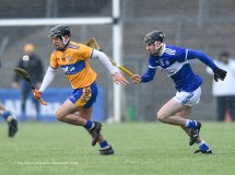 David Reidy of Clare in action against James Keyes of Laois during their National League game at Cusack Park. Photograph by John Kelly