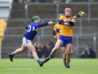 Domhnall Mc Mahon of Clare in action against Willie Dunphy of Laois during their National League game at Cusack Park. Photograph by John Kelly