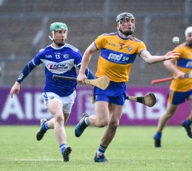 Shane Golden of Clare in action against Ross King of Laois during their National League game at Cusack Park. Photograph by John Kelly