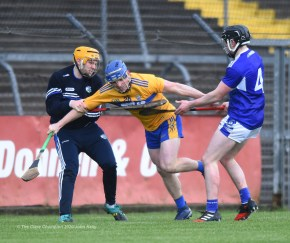 Podge Collins of Clare in action against Enda Rowland and Donnacha Hartnett of Laois during their National League game at Cusack Park. Photograph by John Kelly