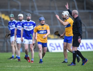 Podge Collins of Clare addresses the referee as Aron Shanagher comes in to help during their National League game against Laois at Cusack Park. Photograph by John Kelly