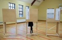 A voter ponders on their choice during voting in the General Election 2020 at Corofin school. Photograph by John Kelly.