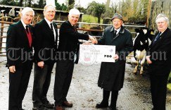 Ennis Lions Club members contributed to the recent Bothar airlift of 70 in-calf heifers from Shannon Airport to 70 peasant families in Albania. This was Bothar's third airlift of Irish heifers to Albania since September 1999. Pictured before the airlift were ( from left) Ennis Lions Club mermbers Tom Mannion and John Costelloe, Danny Coyle handing over cheque to T.J. Maher, chairman of Bothar and Terence Mangan, also of the Ennis Lions Club. Bothar is the Third World aid agency that specialises in the use of livestock in development aid.