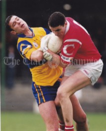 Clare's Paul Hehir and Graham Canty of Cork contest the ball during the Under-21 Championship first round game at Kilmallock. Photograph by John Kelly.