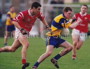 Michael O'Shea of Clare gets away from Cork's Derek Kavanagh during the Under-21 Championship first round game at Kilmallock. Photograph by John Kelly