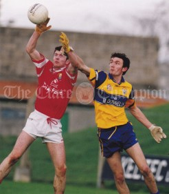 Aerial action from Liam Collins of Cork and John Paul O'Neill of Clare during the Under-21 Championship first round game at Kilmallock. Photograph by John Kelly