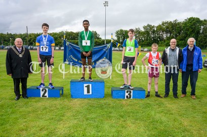 Winners of the Boys U14 100m event were: 1st Promise Jolaoshu (Ennis-St-Johns), 2nd Sean Maher (Inch-Kilmaley-Connolly), Patrick Byrne O'Connell (Lisdoonvarna) and 4th Michael Donnelly (Ballynacally-Lissycasey) pictured with Cllr Pj Ryan (Cathaoirleach Clare County Council), Stuart and Graham Meakins, son and husband of the late Rose Meakins who presented the medals. Photography by Eugene McCafferty