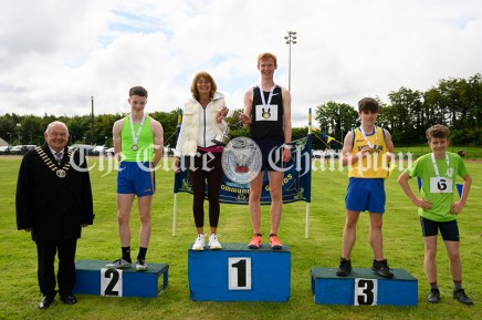 Marie Roche presents the Christy Gormley Memorial Cup to Gerard Dunne from Doonbeg, winner of the U16 Boys 1500m event. In second place was Jack Rush (Lisdoonvarna), 3rd Harry Monahan (Sixmilebridge-Kilmurry) and 4th Dylan Ryan (Doora-Barefield). Photography by Eugene McCafferty