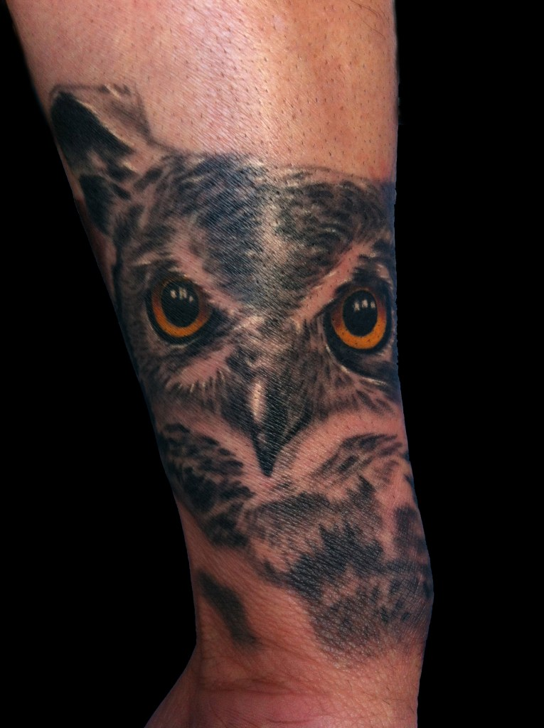 Owl on back of wrist tattoo