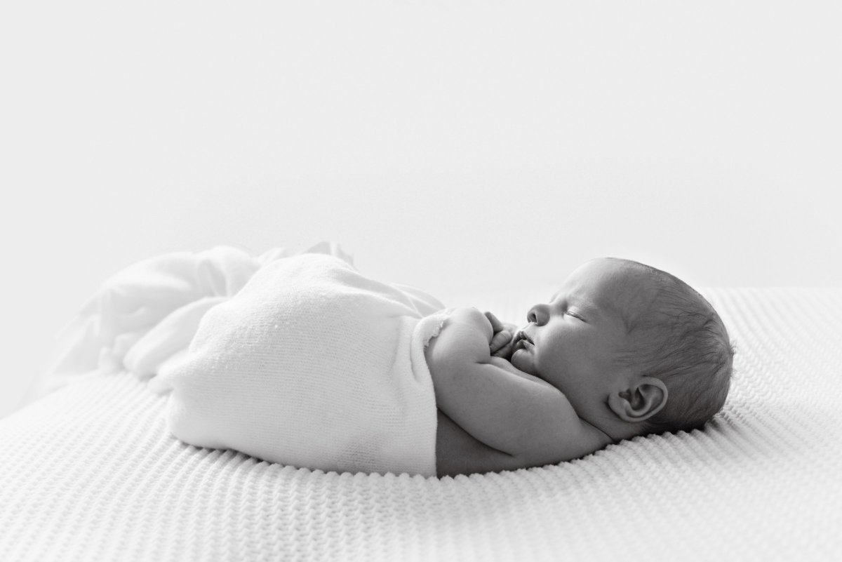When is the best time to book newborn photos