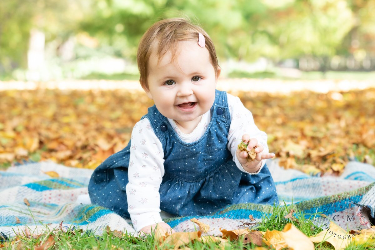 Autumn baby photo shoot in the park