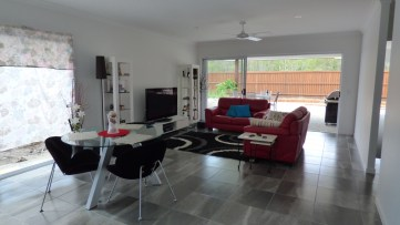 Love this living space, it's so roomy and looks out onto the patio and backyard