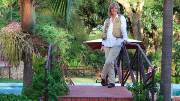Dawn Langley author in tropical garden