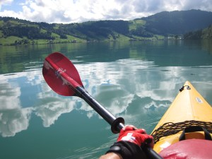 Louise kayaks on the Swiss lake near her home