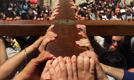 Christians Observe Good Friday: Crushed for Our Iniquities
