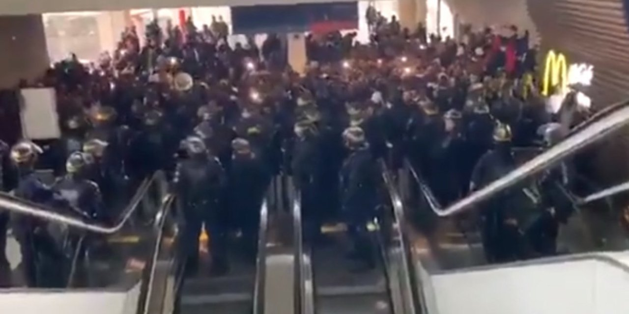 Videos show hundreds of 'undocumented immigrants' blocking entire terminal at Paris airport in hours-long stand-off