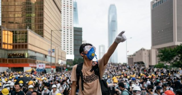 Hong Kong and China Give In to Protesters, Suspend Extradition Bill | Breitbart