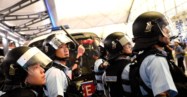 Riot Police Storm Hong Kong Airport as Protesters Refuse to Leave