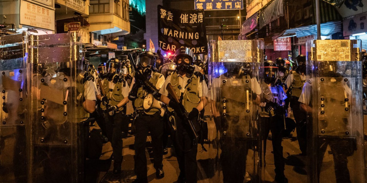 Chinese armored vehicles parked outside Hong Kong fuel fears of military crackdown against protests