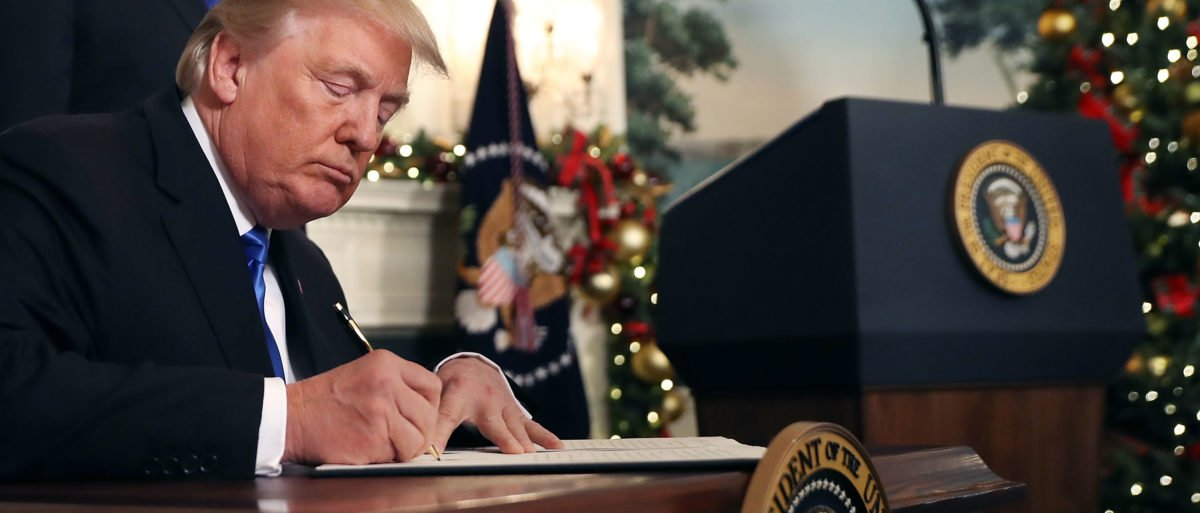 FACT CHECK: Does This Photo Show Trump Signing A $25 Million 'Gun Control Research' Bill?