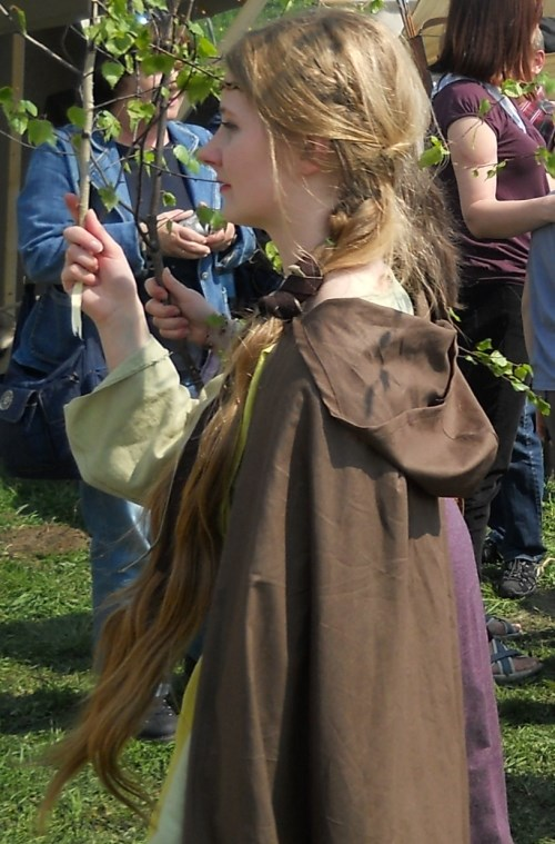 Middle Ages festival and girl with long hair