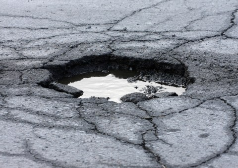Pothole damage costs drivers $3B a year, AAA says