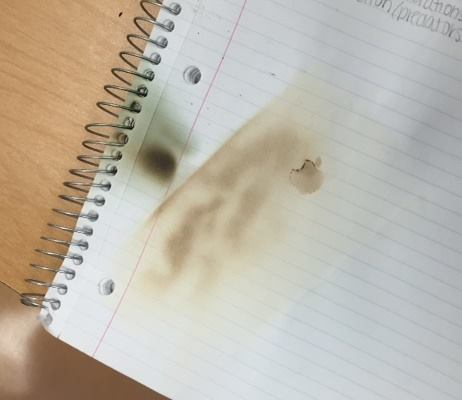 Fire hazard: iPhone burns hole into notebook