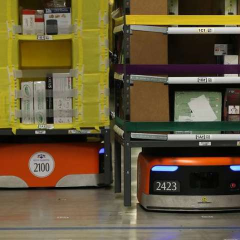 Go behind the curtain, see how Amazon's giant robots fulfill orders