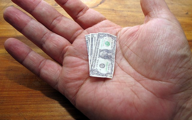 hand with money in small bills