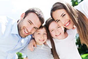 Young family with kids smiling
