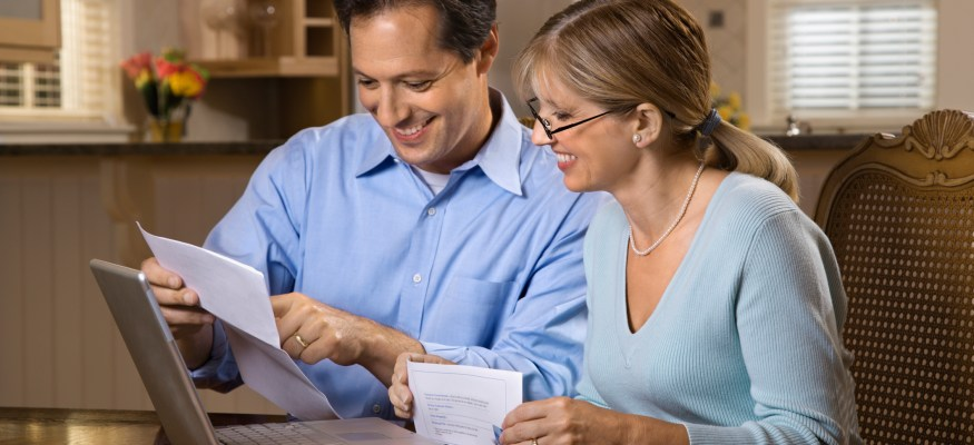 Couple going over finances online