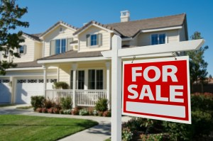 Home For Sale Sign in Front of New House - These hidden fees could be costing you