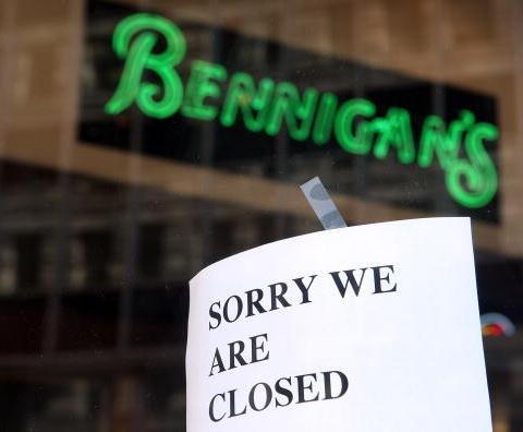 Restaurant with sign saying they are closed.