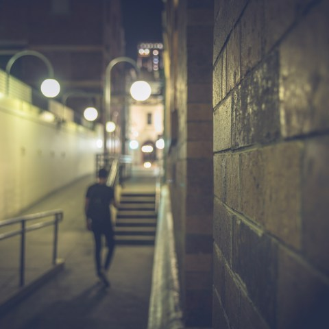 Man walking down dark street