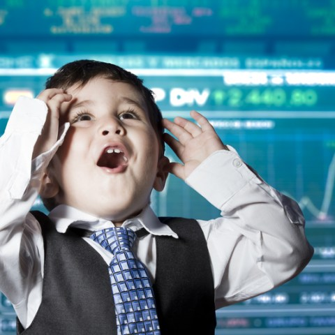 Kid dressed as businessman on Wall Street